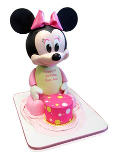 3D Minnie Mouse 1st Birthday Cake Minnie Mouse in 3D is such an exciting cake for a small girl and when we were requested to create her for a 1st birthday our designers were ecstatic! The cake was delivered to Cafe Moments in Elmont, New York for the occasion. We started with a square base covered in a soft white fondant. We then used a pale pastel pink fondant to create a soft flowing cloth for ... http://cmnycakes.com/gallery2…