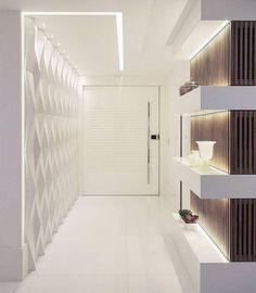 Hall de entrada by Max Mello Arquitetura Destaque para iluminação revestimento 3D e nichos com madeira ripada. @_decor4home