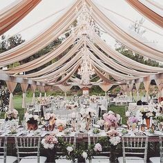 Who loves this luxe & elegant garden wedding like this with gorgeous pastel floral displays, blush drapings & chandeliers #wedding #weddingdecor #weddingstyling #gardenwedding #luxewedding #weddinggoals #outdoorwedding #bohowedding #bohemianwedding #weddingreception #tablescape #tablestyle #floralcenterpiece #floral #pastelflower #chandeliers #flowers #bridal #bridetobe #weddingplanner #bridal #weddinginspo