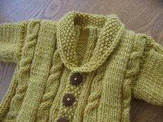 Ravelry: Heirloom Cables Baby Sweater pattern by Lion Brand Yarn.