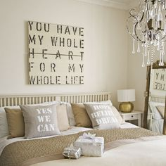 Love the romantic sign above the bed.