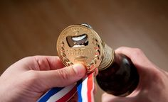 The gold medal bottle opener is great for cracking open a few beers while watching the Olympics, first of all you don't have to stand up, seeing how you have a cooler full of beer right next to you an. Office Gadgets, Home Gadgets, Cool Gifts, Best Gifts, Amazing Gifts, Unique Gifts, Birthday Gag Gifts, American Beer, Gift Ideas
