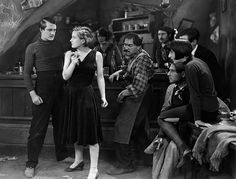 Charles Ray as 'Jerry' and Joan Crawford as 'The Girl' in the 1926 picture Paris To the right of Joan Crawford is Michael Visaroff as 'Rocco'