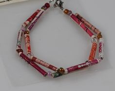 red and pink shades, with multicolored beads, handmade recycled postage stamp beaded bracelet