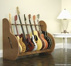The Session™ Deluxe 7 #Guitar Stand is a nice match for this living room decor. View details at https://www.guitarstorage.com/shop/multiple-guitar-stand-deluxe/