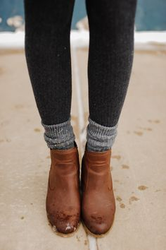 Tights, pushed-down socks, and brown booties.