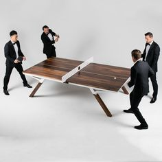 WOOLSEY PING PONG TABLE  8,200.00 The Woolsey Ping Pong Table. In the works for over a year, and finally available after countless hours of rigorous product testing. Designed and crafted to the ITTF spec size, the Woolsey Ping Pong table is able to transform from a dining or conference table, and in a matter of seconds can be ready for game play. A solid Black Walnut top is suitable for years of play,with a Sugar Maple center line for those intense doubles matches.A regulation size powder…