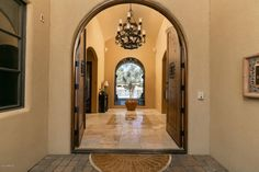 Welcome to this Elegant Spanish Mediterranean Paradise Valley estate with old world charm, heads to auction May 26th 2016...
