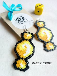 Yellow pixelart Candy Crush earrings with a 8bit retro feel made of Hama Mini Perler Beads, perfect for those sugarlovers! by SylphDesigns