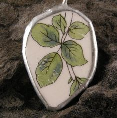 Check out this item in my Etsy shop https://www.etsy.com/listing/197434562/pendant-porcelain-shard-ooak-green
