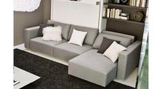 Mueble cama abatible vertical de matrimonio con sofá y chaise longue extensible.