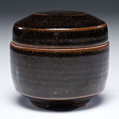 Warren MacKenzie (1924, USA) Small Lidded Box c.1977. Stoneware. ht. 4.25, dia. 4.25 inches. The first American apprentice of famed artist Bernard Leach, this covered box is made of stoneware with a rich tenmoku glaze.