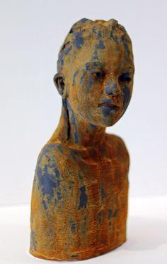 The ceramic sculpture has been painted with iron paint and sprayed with a rusting solution. First time I have tried this and I love the effect.