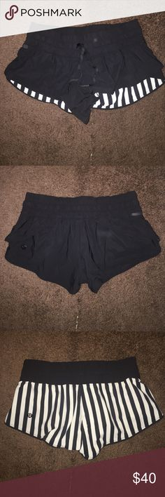 Lululemon running shorts Reversible shorts. Black on one side, black and white strips on the other side. Unlined. Size 2/4. Small, discrete pocket with key strap. lululemon athletica Shorts