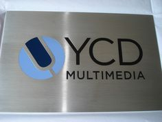 Brushed satin aluminum metal plaque with etched logo, etched copy paint filled 3 colors PMS, clear coated in NYC. We specialize in custom metal signage in New York, NY. Visit our website below to contact us for a free consultation! www.SignsVisual.com