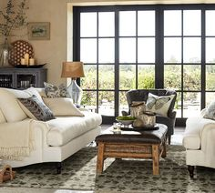 white sofa - JAM advice: unskirted sofas make a room feel bigger. GREAT tip for those of us with small homes!
