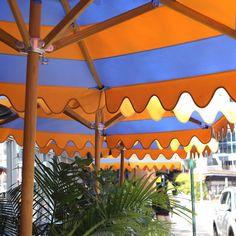 Orange & Blues Stripes on Patio Umbrella.
