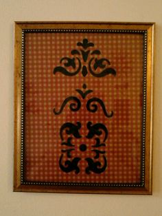 Stenciled $Tree frame backed w/ wrapping paper & stenciled w/ green permanent marker