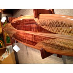 KOA Surfboard.  Made in Hawaii by Haleiwa Surfboard Co.  Koa, mango,  and cedar wods.  Hollow, foam core. Perfectly shaped and glassed. Incredible!  Only at Martin & MacArthur.  808-591-1949