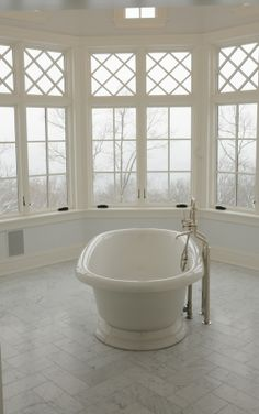 master bath--Lovely features, but there is not enough contrast between the blue walls and the white floor, tub and window trim.  If the blue was darker, the white would pop.