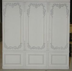 tip: wall paneling embellished with jewelry findings then painted