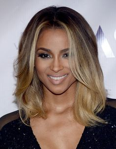 Ciara's blown out, center part hairstyle looks sultry and glamorous, perfect for prom!