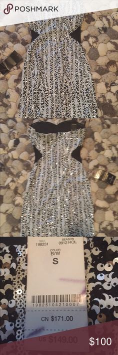 Bebe Sequin Dress Black and white Bebe sequin dress with mesh cutouts on the sides. Never worn, new with tags bebe Dresses Mini