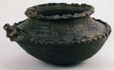 Chuko Vessel ( Jomon)  This spouted vessel was made during the Final Jomon period (1100-400 B.C.E.). It is an example of black-burnished pottery.