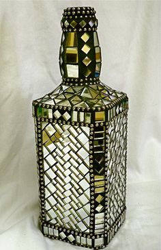 This is a large size Jack Daniels bottle that I have rescued from a trip to the landfill, and repurposed with mosaic mirror tiles, ball chain and Mosaic Bottles, Mosaic Vase, Mirror Mosaic, Mirror Tiles, Mosaic Planters, Wine Bottle Art, Diy Bottle, Wine Bottle Crafts, Altered Bottles