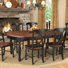 A chic complement to bone china and gleaming silverware, this charming wood dining table showcases a antique oak and black dual-tone finish and an extendable...