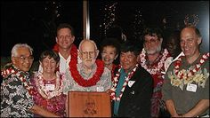 "2001 Hall of Fame Inductee: Tom Ferguson.  From left to right: Tommy Kono, Edith Leiby, Jim Barahal, Tom Ferguson,   Jeanette and Ronald Chun, Jack Scaff, and Jon Cross pictured at the annual marathon dinner.  ""Tom Ferguson was a driving force in the development of the Honolulu Marathon. Tom designed, laid out, and measured the original Marathon course and did innumerable behind-the-scenes jobs over the years. Tom is one of the unsung heroes of the Honolulu Marathon."""