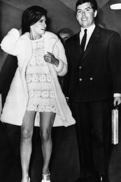 For her second marriage, in Paris  1967, Raquel Welch wore a sexy crochet dress and she teamed it with a three-quarter length white fur coat.