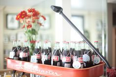 Here are some of the beverages for the Kelly's baby shower.  We got the Coke bottles at Costco and borrowed the wagon from our friend Heidi. My sister bought the tags from Big Lots, stamped them with the wagon stamp that said Logan's name   #coke #bottles #wagon #hostess #with #the #mostess #red #party
