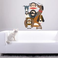 Dog wall stickers are popular in a kid's bedroom design. A decal featuring Julius the monkey with four canine friends would be a delightful addition to a kid's room. Your kids could have fun choosing names for the dogs.