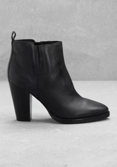 High heel, leather ankle boots with a Western-style silhouette.