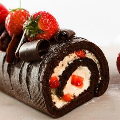 This chocolate swiss roll recipe can made with or without the strawberries and chocolate curls.. Chocolate Swiss Roll Recipe from Grandmothers Kitchen.