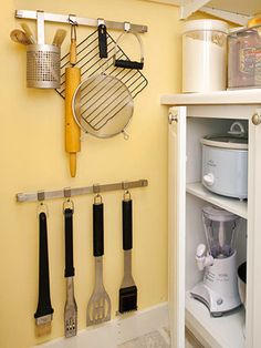 PANTRY ORGANIZATION Zone Tools and Appliances Hang bulky or seldom-used utensils from hooks mounted on the wall or back of the door. If space allows, store specialty appliances in the pantry, too. Kitchen Utensil Organization, Pantry Storage, Kitchen Storage, Organization Ideas, Storage Ideas, Utensil Storage, Household Organization, Food Storage, Storage Solutions