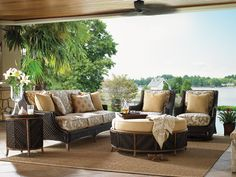 Tommy Bahama - Island Estate Lanai collection. Wicker sofa, end table, wing chairs and storage ottoman.