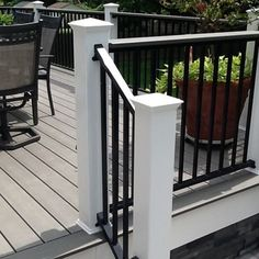 Lots of Gray here. Gray deck with matching stone both hard scarp and faux stone skirting Front Porch Railings, Deck Railings, Grey Deck Stain, Gray Deck, Black Deck, White Deck, Landscaping Around Deck, Outdoor Deck Decorating, Deck Colors