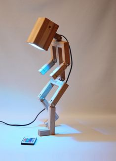 http://sosuperawesome.com/post/159114442125/wooden-lamps-including-articulated-people-by