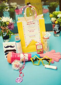 """FAVORS:  for the kids we gave them each """"The Ultimate Beatles Fan Bag."""" Contents included:  - a set of Beatles mustaches-rock star sunglasses  -""""I Want To Hold Your Hand"""" clappers that lit up  -""""Kaleidoscope Eyes"""" (a kaleidoscope)  -hippie beads-a microphone-a """"Lucy In The Sky With Diamonds"""" ring (Ring Pop)  -a handful of change from """"Penny Lane"""" (a roll of pennies)  -rock star candy-and Beatle Juice (a juice box)"""