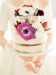 Romantic floral topped naked cake: http://www.stylemepretty.com/destination-weddings/2016/04/22/a-royal-celebration-complete-with-cakes-and-a-crowned-puppy/ | Photography: Ashley Ludaescher - http://ashleyludaescher.com/
