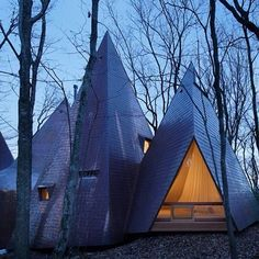 """Next in our roundup of woodland architecture is a retreat in Japan designed to resemble a cluster of tepees. Each individual dwelling is topped by a """"pointy hat"""" that gives the timber structure the appearance of a group of pitched tents. See more forest buildings on dezeen.com/tag/woodland #architecture #timber #Japan #woodland"""