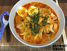 Generally, laksa consists of rice noodles or rice vermicelli with chicken, prawn or fish, served in spicy soup; the soup is either based on rich and spicy curry coconut milk, or based on sour assam… Laksa Soup, Curry Laksa, Spicy Recipes, Asian Recipes, Cooking Recipes, Indonesian Recipes, Oriental Recipes, Indonesian Food, Milk Recipes