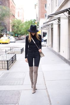 "Neutral coloured over the knee boots will look great paired with an all black outfit. Via Lisa D Cahue. Turtleneck: Velvet, Jeans: DL 1961, Hat: Rag & Bone, Boots: Stuart Weitzman ""Highland"