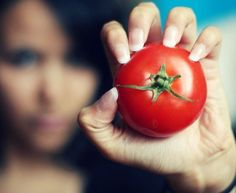 The depth of field in this picture makes the subject (tomato) really stand out, while you can still see the background (the girl). Its interesting because it incorporates the rule of thirds along with depth of field.