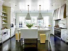 La Cornue, Lee Industries by McAlpine and large pendants.  Love this kitchen by Melanie Turner