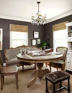 love the neutral yet still rich colour of the walls and the round table