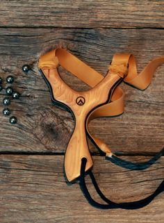 """The BCX Sling Shot is a very unique design that has it's shape inspired by our axe handles. This limited run piece is hand cut and shaped for BCX by Nathan Masters… the master of all things slingshot. A fork supported style of slingshot with an """"over the top"""" banding profile, this slingshot is extremely powerful. The Spectraply laminate core ensures strength and the Hickory scales make it a BCX beauty, a true function meets ..."""