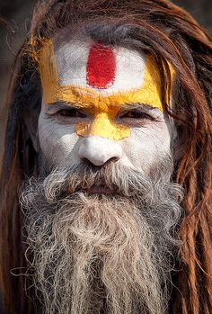 Yellow and White.  Sadhu (Hindu Holyman) at Pashputinath temple, Kathandu by Michael Anderson